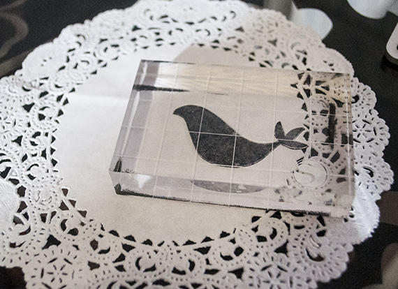 stamped bird on doily