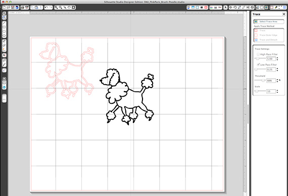 poodle traced in silhouette